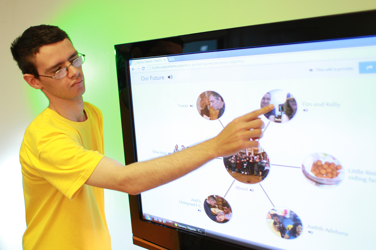 Young person showing Wiki on touchscreen