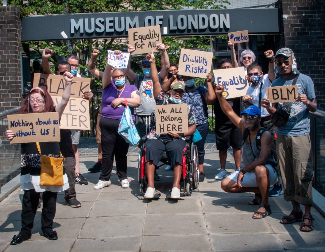 group of disabled people with placards